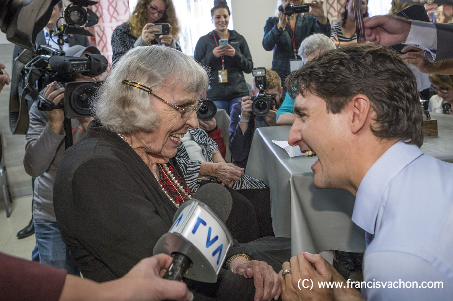 Marie-Paule Savard, 101, shakes hands with Prime Minister Justin Trudeau at a seniors' home in Roberval, Qc, on Thursday October 19, 2017. THE CANADIAN PRESS/Francis Vachon.