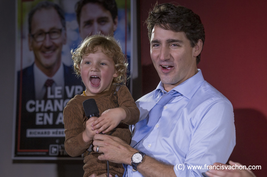 Justin Trudeau and his son Hadrien, 3, are seen during a liberal rally in Dolbeau-Mistassini, Qc, on Thursday October 19, 2017. THE CANADIAN PRESS/Francis Vachon.