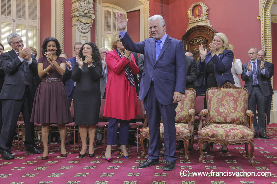 Quebec Premier Philippe Couillard gestures as the new new Liberal cabinet applauses at the National Assembly in Quebec City October 11, 2017. THE CANADIAN PRESS/Francis Vachon.